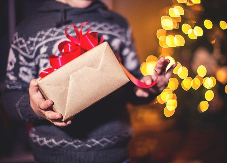 Young boy opening Christmas present