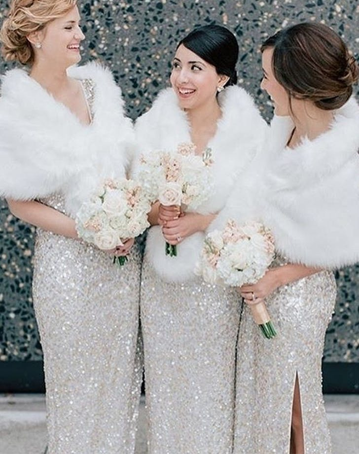 Winter wonderland wedding ideas that are pure magic purewow sparkly bridesmaids in faux fur junglespirit Choice Image