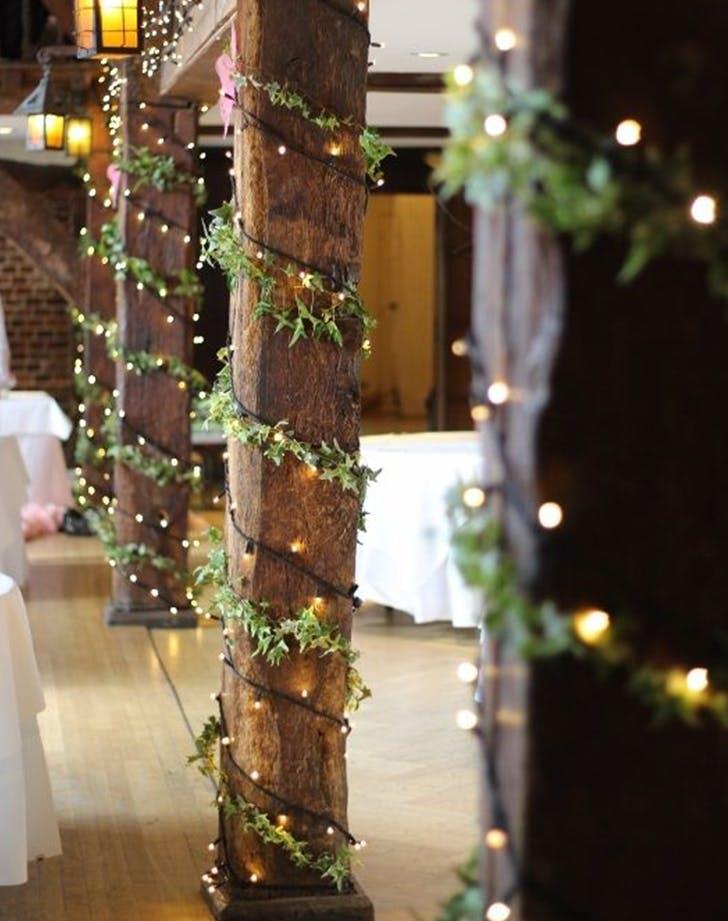 holly wrapped columns winter wedding decor ideas