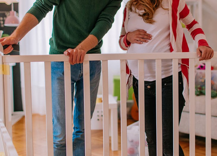 pregnant couple crib building