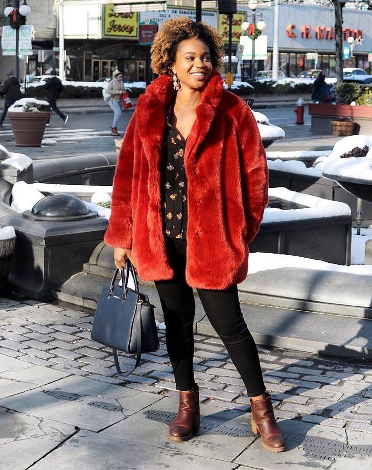 red faux fur coat coterie member
