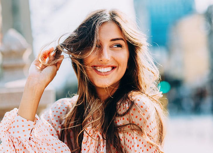 woman smiling long hair