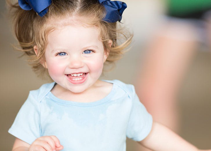 Cute toddler girl Terese laughing
