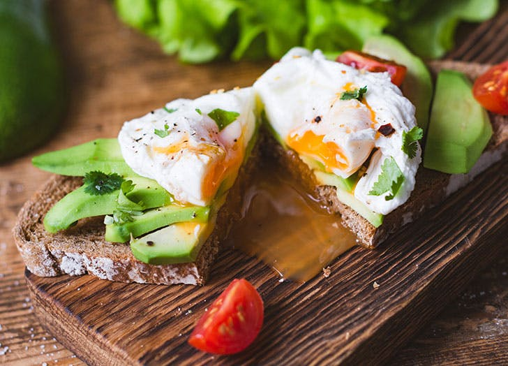 Keto diet preparation of egg and avocado on toast