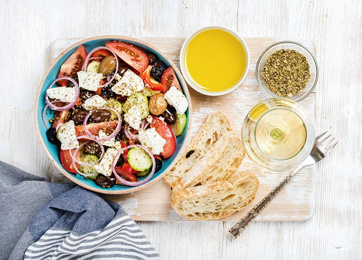 Mediterranean diet Greek salad with olive oil and wine