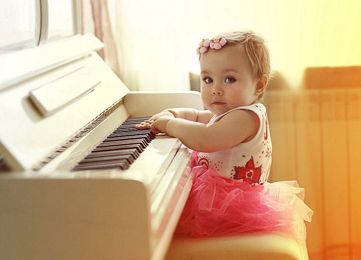 Norwegian baby girl Elin playing piano