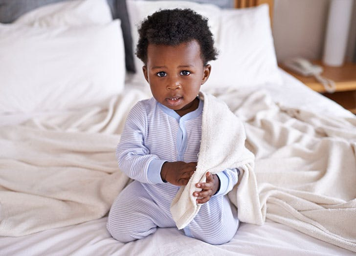 Shot of an adorable little baby boy at home in bed