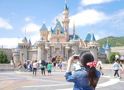 Woman taking photo at Disneyland 400