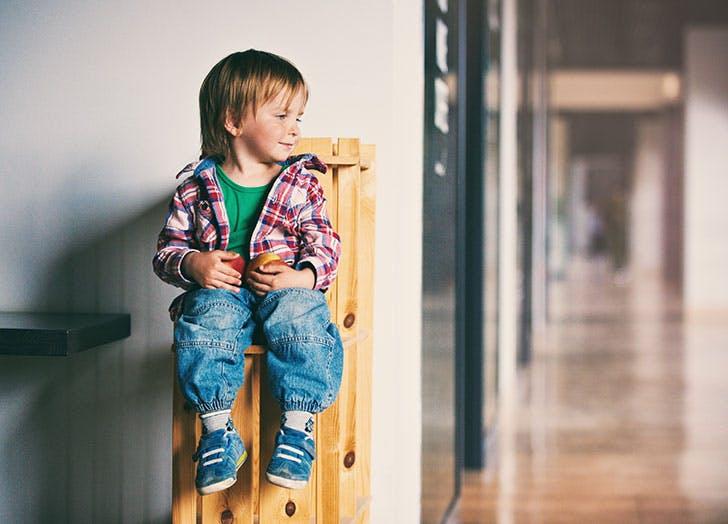 Young boy sitting in school
