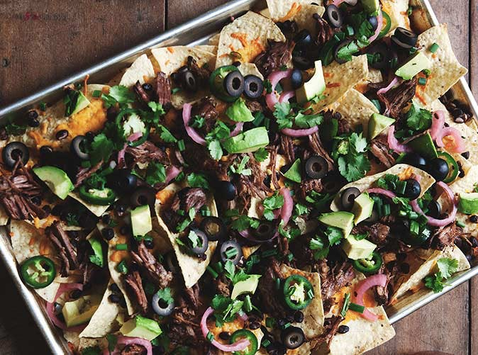 beer braised steak nachos pickled onions pico de gallo
