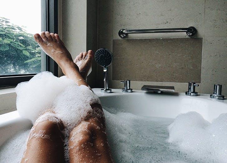 legs in bubble bath