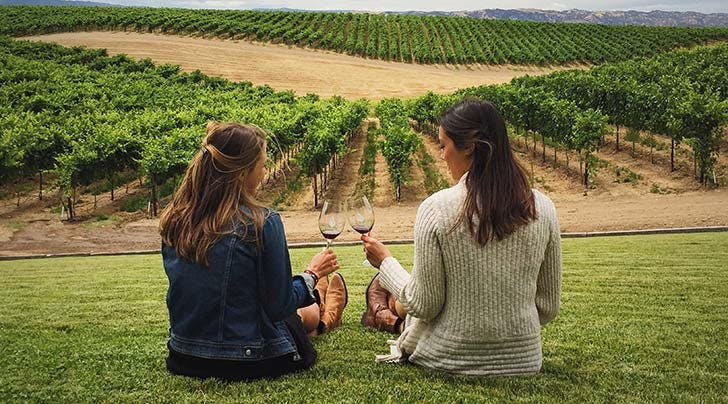 two women drinking biodynamic wine hero