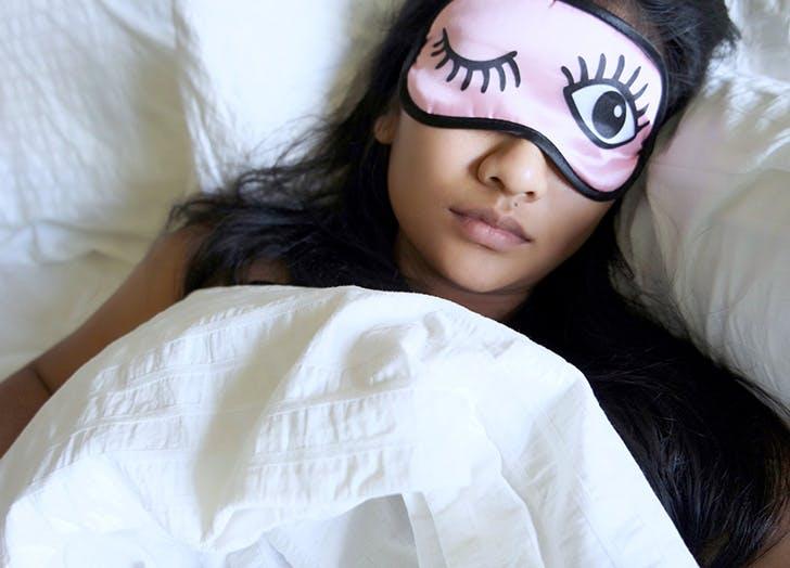 woman wearing sleeping eye mask