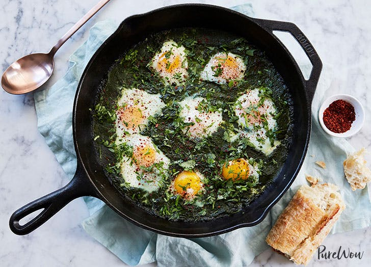 Green shakshuka in pan