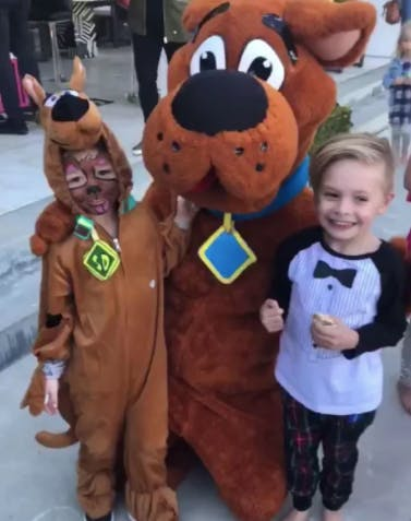 Gwen Stefani s son apollo posing with Scooby Do at birthday