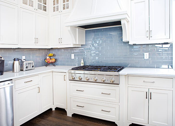 White kitchen with stove that needs baby proofing