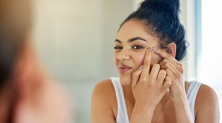 How To Pop A Pimple Safely And Prevent Infection Purewow