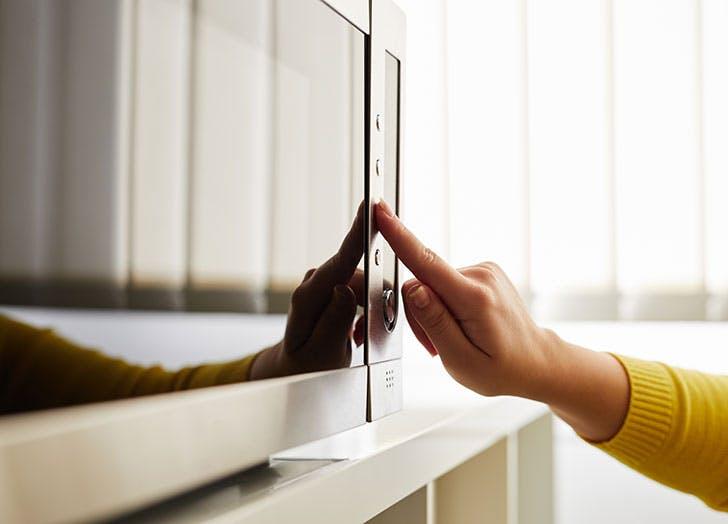 Woman using microwave