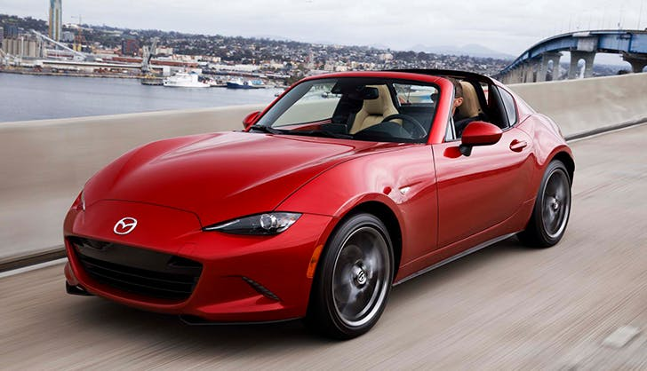 a bold red mazda miata sports car
