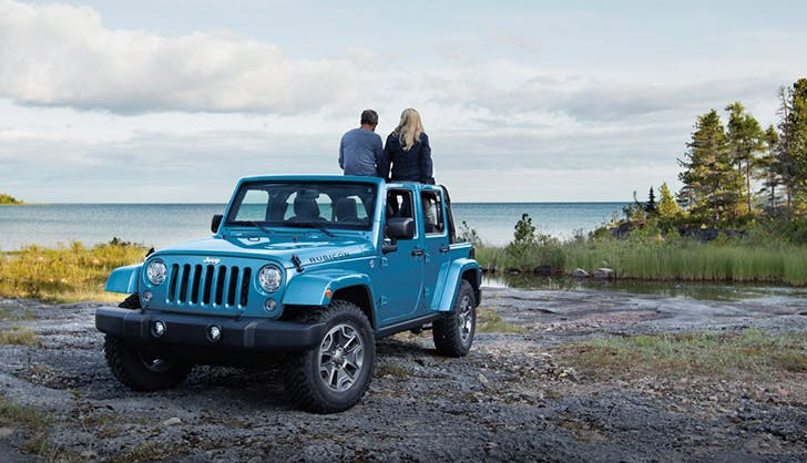 a couple enjoying their jeep wrangler in the great outdoors