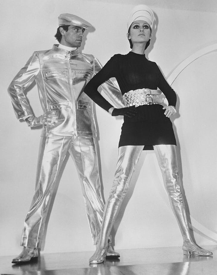 a couple wearing space age clothes in the 60s