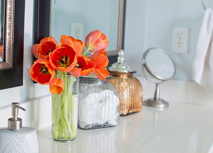 bathroom sink with vase of flowers