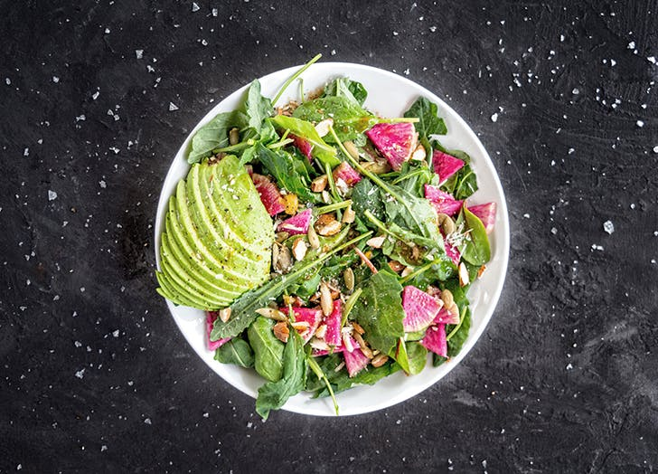 bowl of salad with avocado and radishes