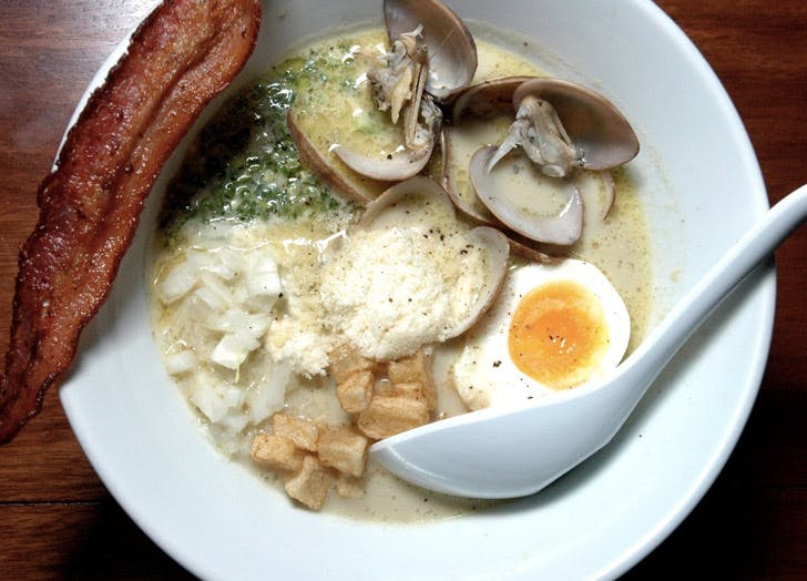 bowl of ramen with bacon egg and clams