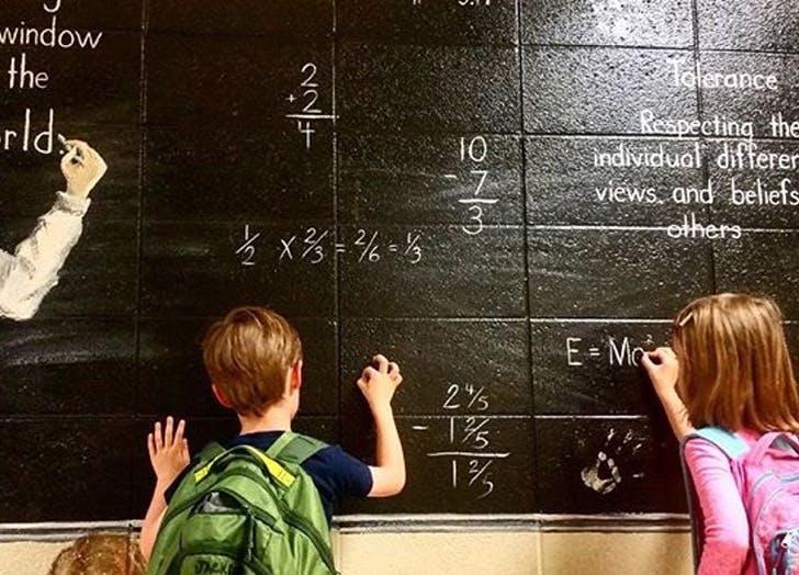 children boy girl chalkboard