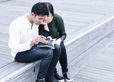 couple reading together msn