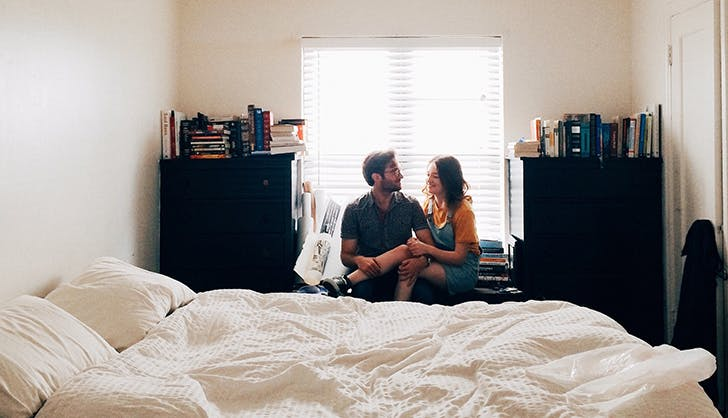 couple sitting in their bedroom
