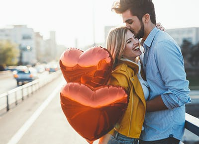 cute couple with heart balloons