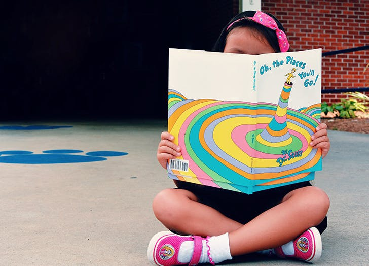girl reading oh the places youll go