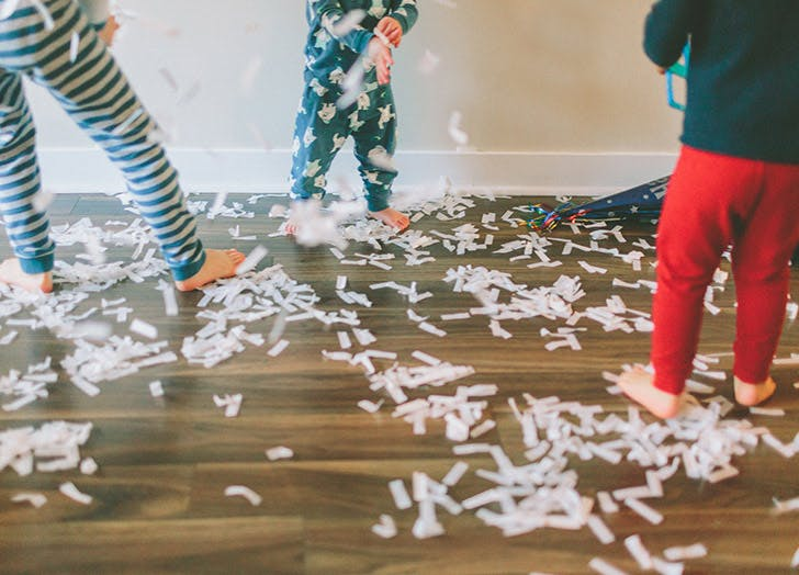 kids in pajamas throwing confetti