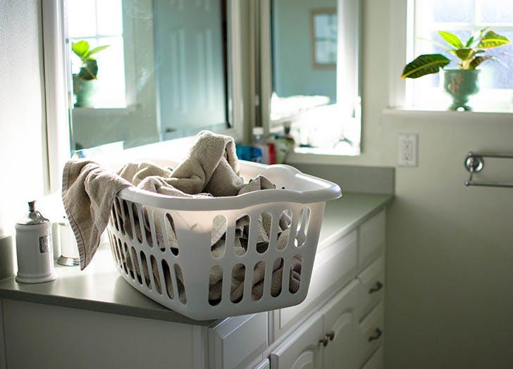 laundy basket on bathroom sink