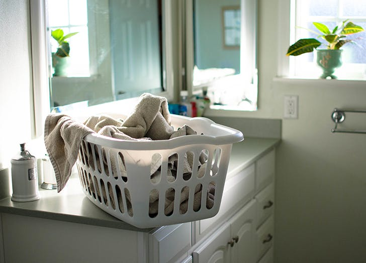 laundy basket on bathroom sink