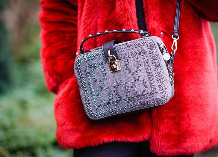 lavender bag red coat