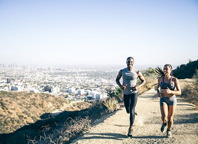 man and woman running in los angeles 400