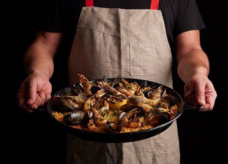man holding paella
