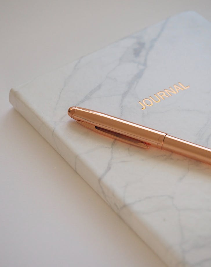 marble print journal with rose gold pen