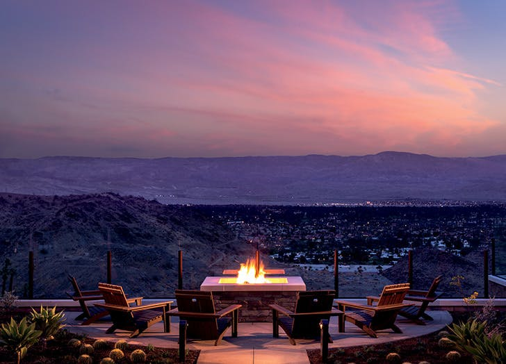 outdoor fire pit in palm springs at sunset