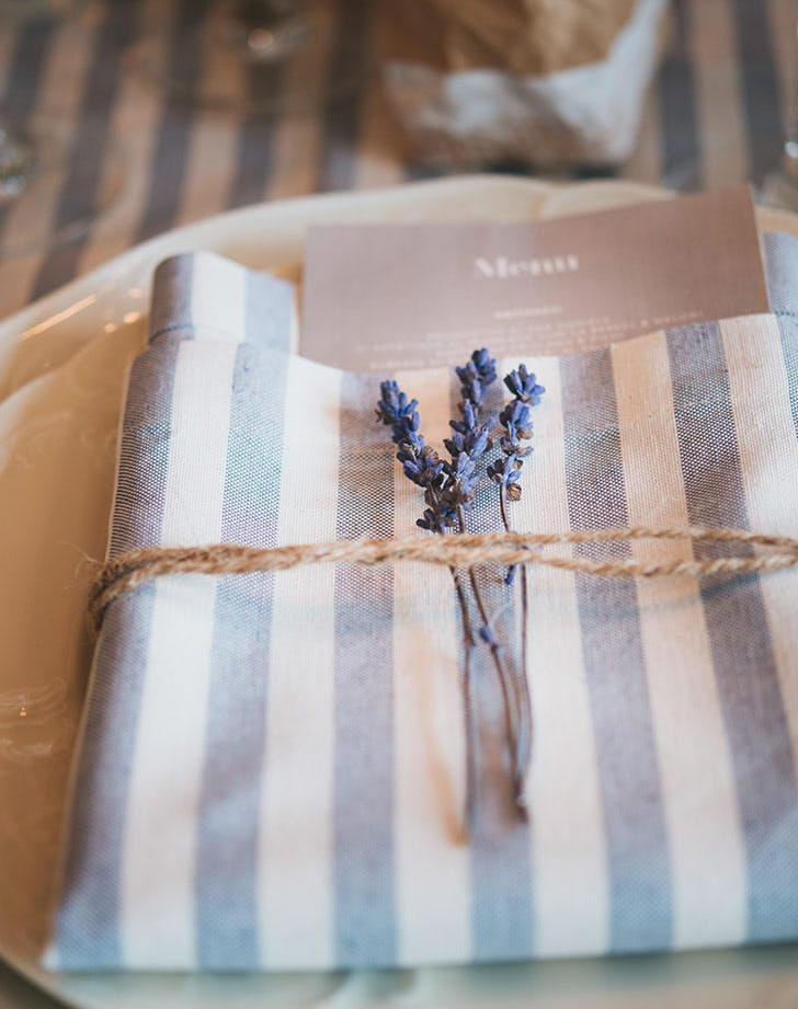 place setting with dried lavender and striped napkin