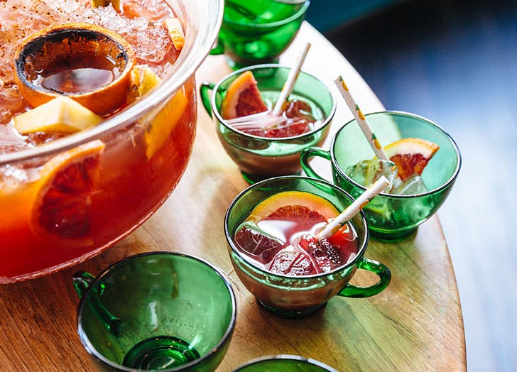 punch cocktail in green glassware