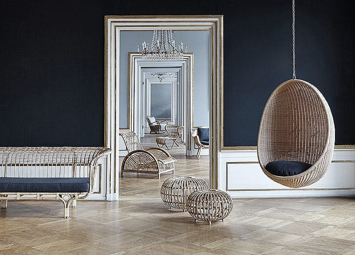 rattan hanging chair in blue room