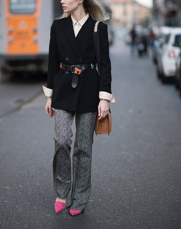 woman wearing belted blazer and pink shoes