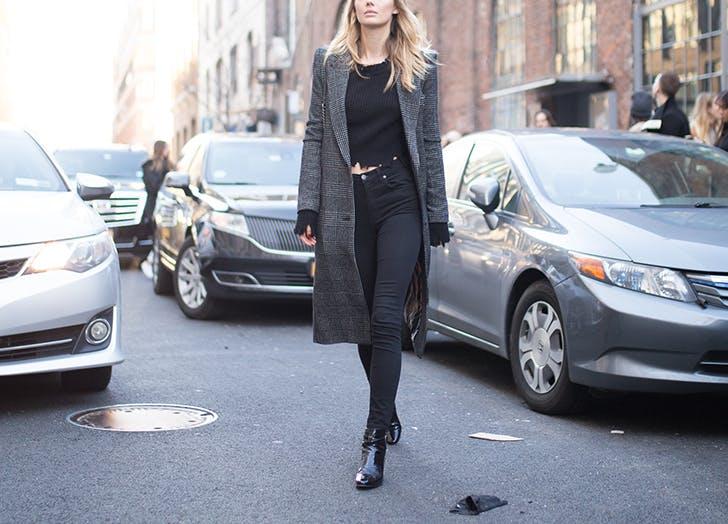 woman wearing black pants top and coat