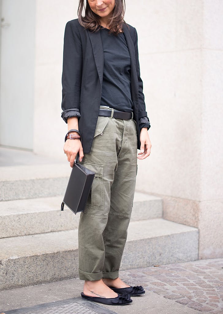 woman wearing cargo pants a blazer and flats
