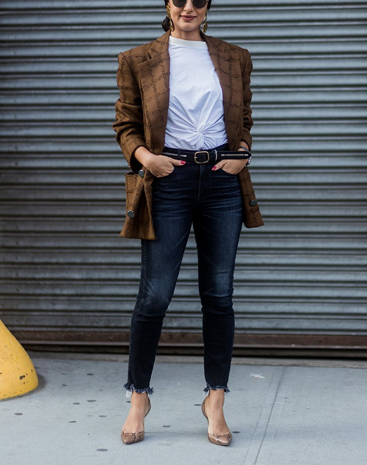 woman wearing dark skinny jeans and a blazer