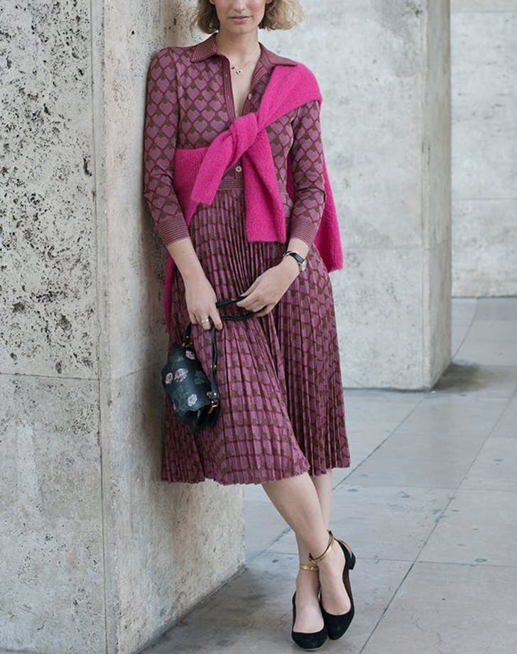 woman wearing dresss with sweater tied around her shoulder