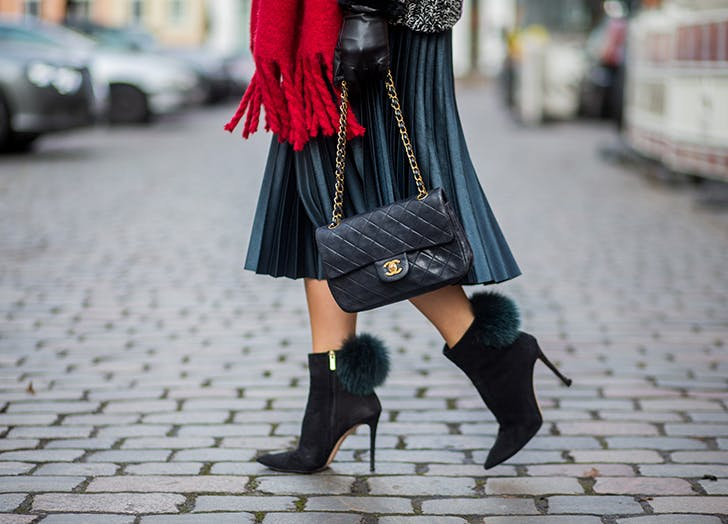 woman wearing midi skirt and black booties